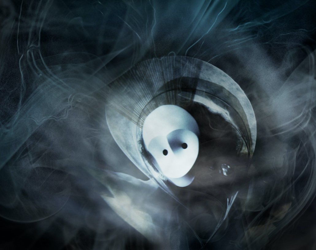 White mask with smoke and black background.