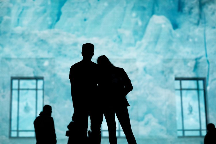 Two figures standing in front of Joseph Michael's - 'Antarctica while you were sleeping'