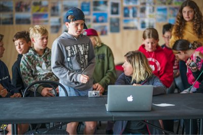 Wānaka student in front of group in workshop