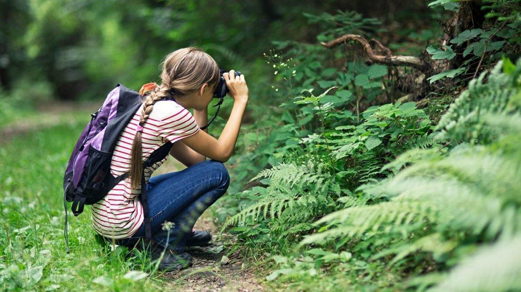 Girl taking photo in the bush