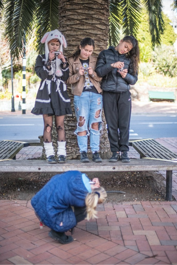 Students practising the use of different camera angles with expert photographers Tatsiana Chypsanava and Raymond Sagapolutele. Image credit Raymond Sagapolutele